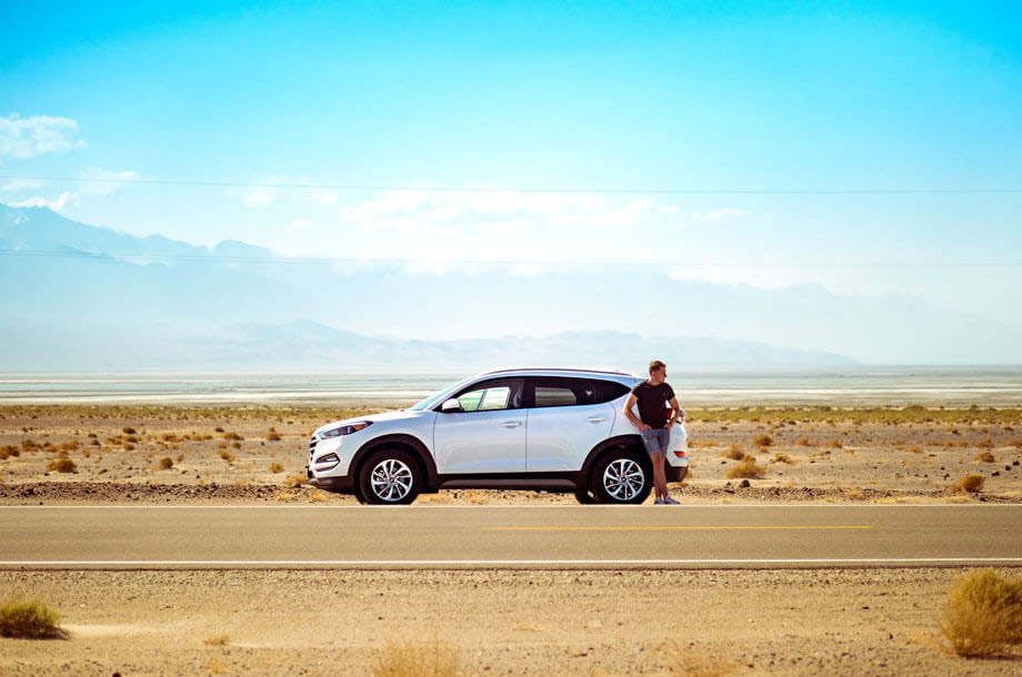 Man standing on side of road with car photo | Mutual Insurance | Auto Insurance